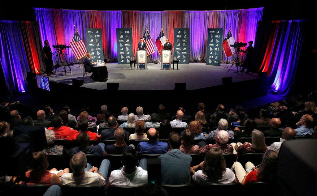 The audience listens to Dallas City Council member Scott Griggs (center, left) and State Rep. Eric Johnson, D-Dallas (right), debate during a televised one-hour debate sponsored by The Dallas Morning News, NBC5 and the Dallas Regional Chamber at El Centro College in downtown Dallas, Tuesday, May 14, 2019. Dallas Morning News political reporter Gromer Jeffers (left) and NBC 5 political reporter Julie Fine moderate the debate.  The two candidates are in a runoff election to become Dallas Mayor. (Tom Fox/The Dallas Morning News)