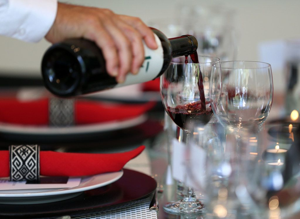 A glass of 17 Pinea wine is poured before a tasting at a home in Dallas.