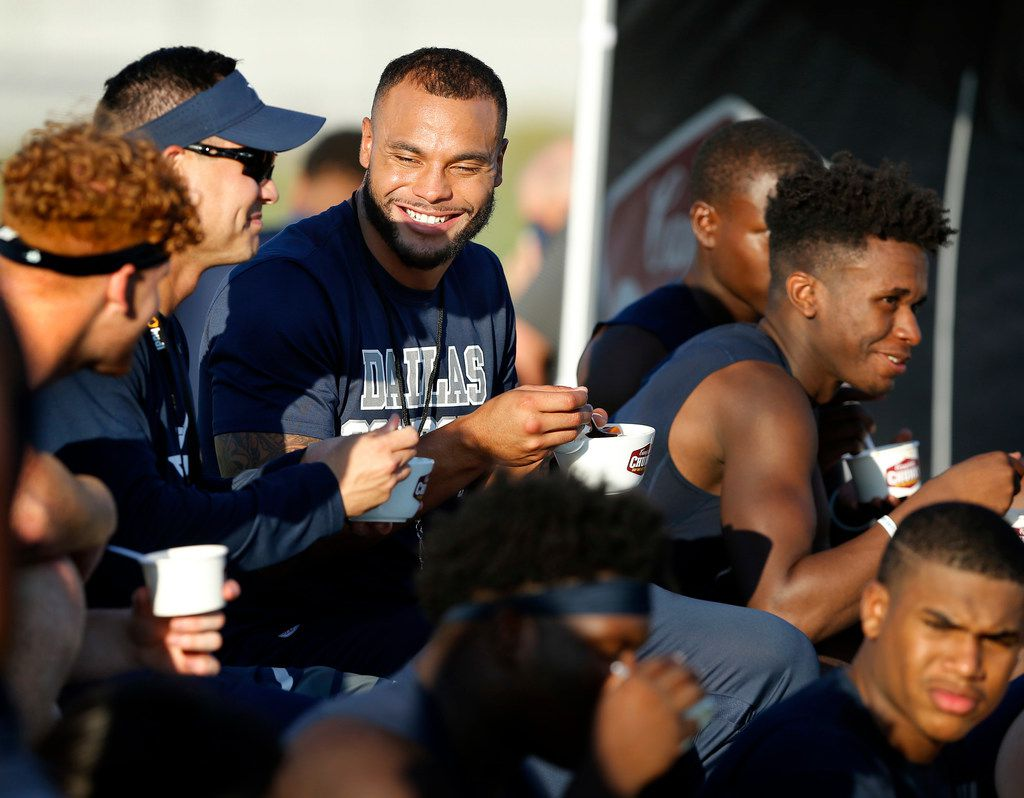 Dallas Cowboys quarterback Dak Prescott (center) joined Lone Star High School football coach Jeffrey Rayburn (left with visor) to film a Chunky Soup commercial at the schools practice field, Monday, September 17, 2018. (Tom Fox/The Dallas Morning News)