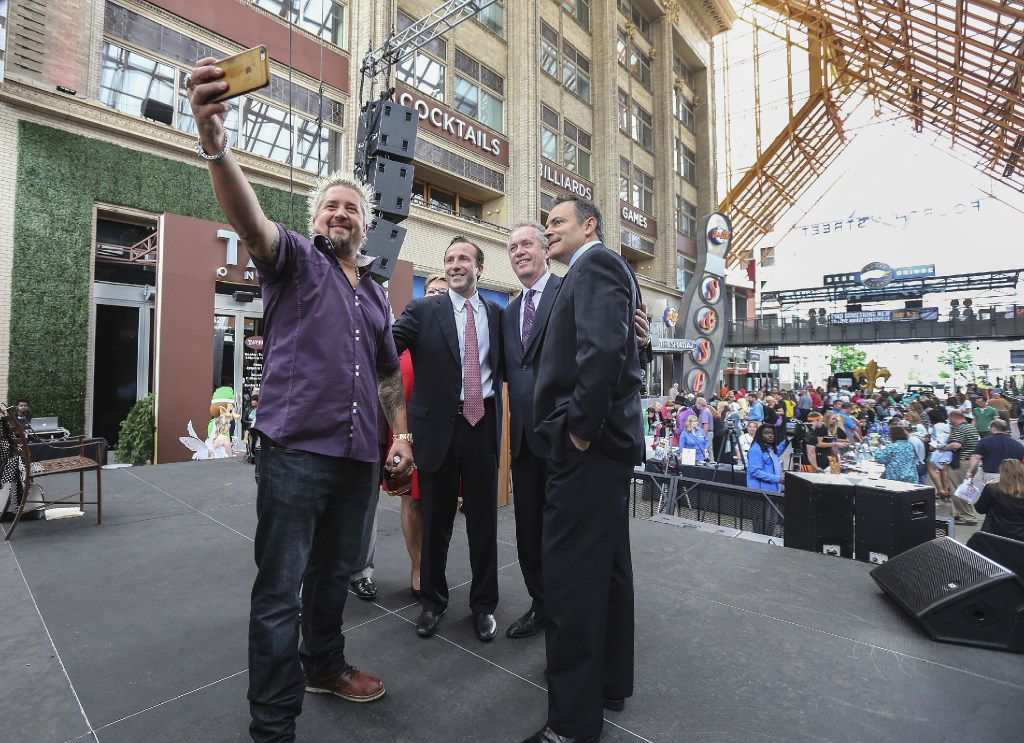 Guy Fieri (far left) gets a selfie with (from left to right) Reed Cordish, Mayor Greg Fischer and Governor Matt Bevin after a press conference announcing his new restaurant at Fourth Street Live! called Guy Fieri's Smokehouse, on May 10, 2016. Fourth Street Live! is an entertainment, retail and office district developed in partnership by The Cordish Companies, the City of Louisville and the state of Kentucky.