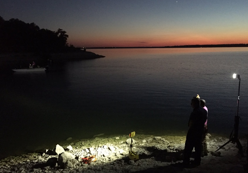 Dive crews search for the body of a missing swimmer Wednesday evening at Lake Benbrook.