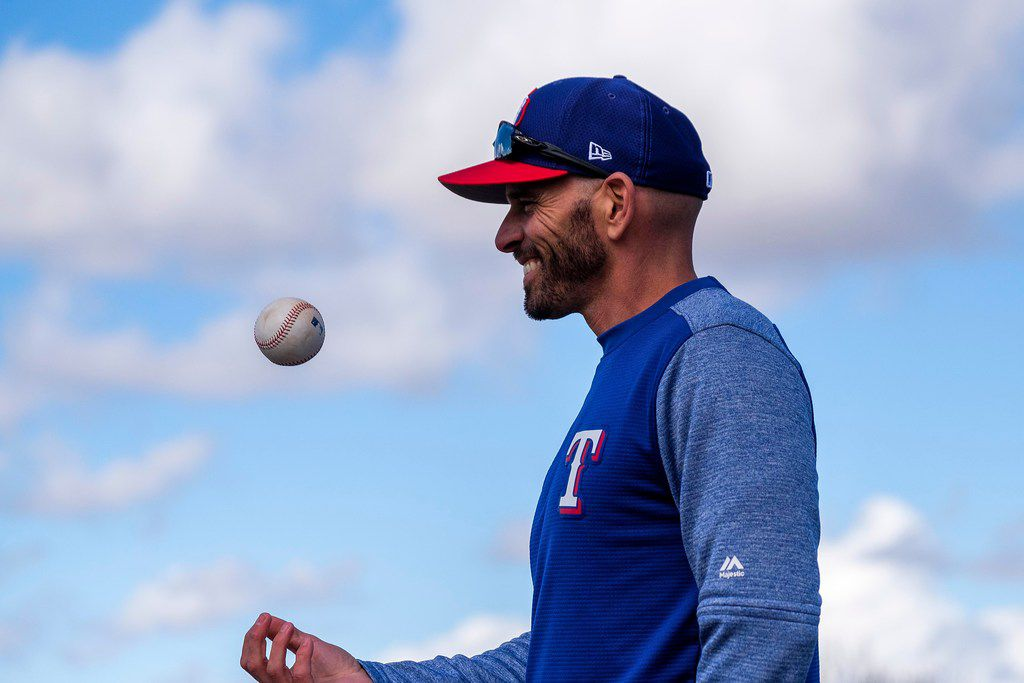 Texas Rangers manager Chris Woodward tosses a ball as he watches his team during the first full squad spring training workout at the team's training facility on Monday, Feb. 18, 2019, in Surprise, Ariz.. (Smiley N. Pool/The Dallas Morning News)