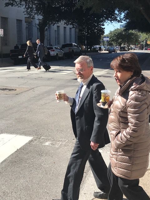 James Godwin walks to federal court in Fort Worth for a trial in which he is trying to force the government to return his seized dinosaur fossil.