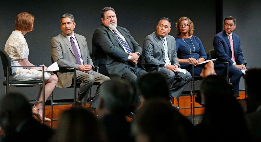 Monica Egert Smith of Communities Foundation of Texas asks questions of (left to right) Andres Alcantar, commissioner of the Texas Workforce Commission; Neil Matkin, president of Collin College; Michael Medalla, manager of Toyota USA Foundation; Alfreda Norman, senior vice president of Federal Reserve Bank of Dallas; and George Tang, managing director of Educate Texas, at a panel discussion on STEM education and   workforce development, held at Toyota North American Headquarters in Plano.