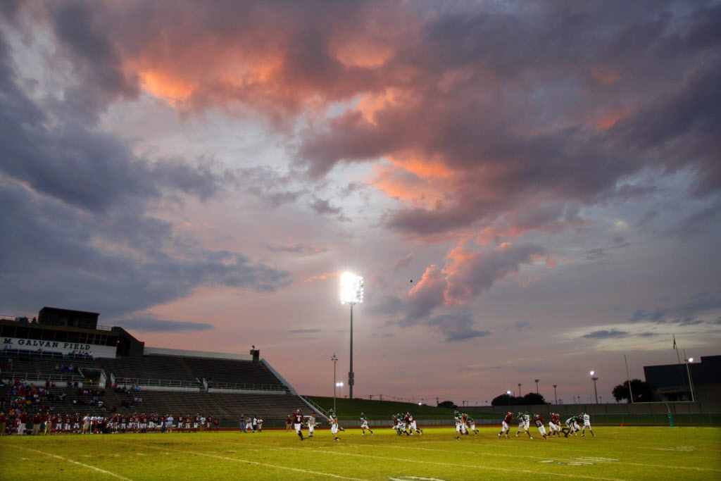 ORG XMIT: *S197CAC4F* The rain clouds parted long enough to reveal a sunset on the clouds during first half UIL high school football action between Kennedale High and Fort Worth Southwest  High at the Southwest High field on Saturday, September 19, 2009. (John F. Rhodes / The Dallas Morning News )