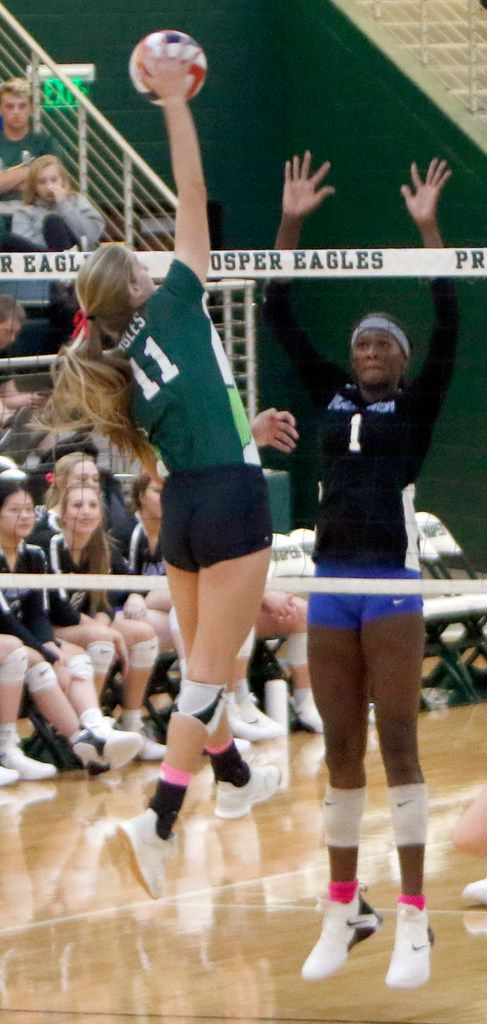 Prosper's Shaylee Shore (11) skies to spike against the defense of Iman Ndiaye (1) during the first game of their match. The two teams played their District 9-6A volleyball match at Prosper High School in Prosper on October 22, 2019. (Steve Hamm/ Special Contributor)