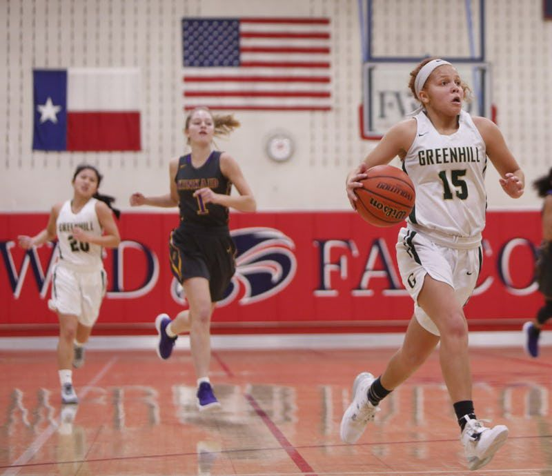 Greenhill's Jade Currington (15) bolts to the basket during second half action against Houston Kincaid. The two teams played in the girls basketball title game of the SPC Championships held at Country Day School in Fort Worth on February 16, 2019. (Steve Hamm/ Special Contributor)