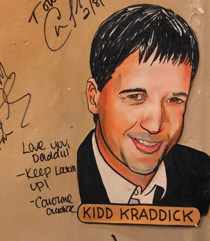 Caricature of the late radio personality Kidd Kraddick on the wall at the Palm restaurant in Dallas.
