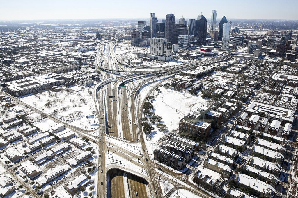 Snow covered downtown Dallas after a record snowfall on Thursday, March 5, 2015. Overnight snow and sleet blanketed the region, piling up to 2 to 5 inches across much of the area.
