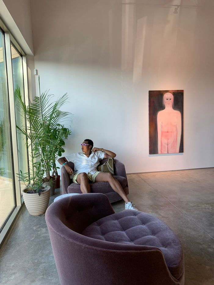 Joshua McAfee seated with (on wall) Miriam Cahn, 'angebot / stilwechsel', 200, oil on linen