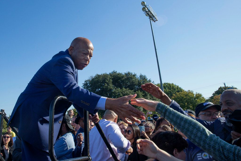 "John Lewis, civil rights icon and Representative for Georgia's 5th Congressional District, left, greets people after he spoke to the crowd at Fretz Park in Dallas on Saturday, October 27, 2018. Lewis led the March 7, 1965, Bloody Sunday protest in Selma, Alabama. ""I gave a little blood on that bridge for the right to vote,"" Lewis said."