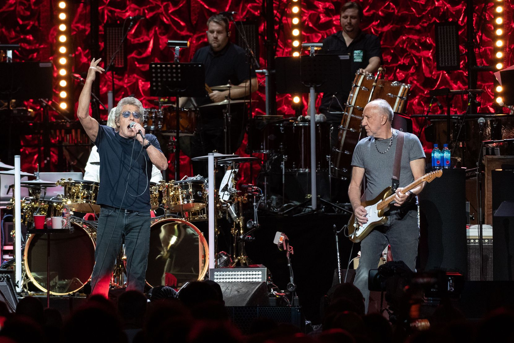 """Roger Daltrey (L) and Pete Townshend of British rock band """"The Who"""" perform at the Toyota Center on the second leg of their Moving On! tour on September 25, 2019 in Houston, Texas."""