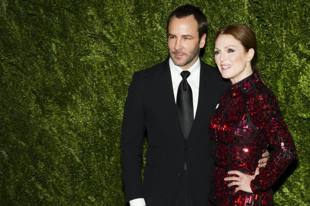 The devilishly handsome designer doesn't just design looks for the red carpet, sometimes he walks the carpet himself. Here, A-list friend and actress Julianne Moore joins him.