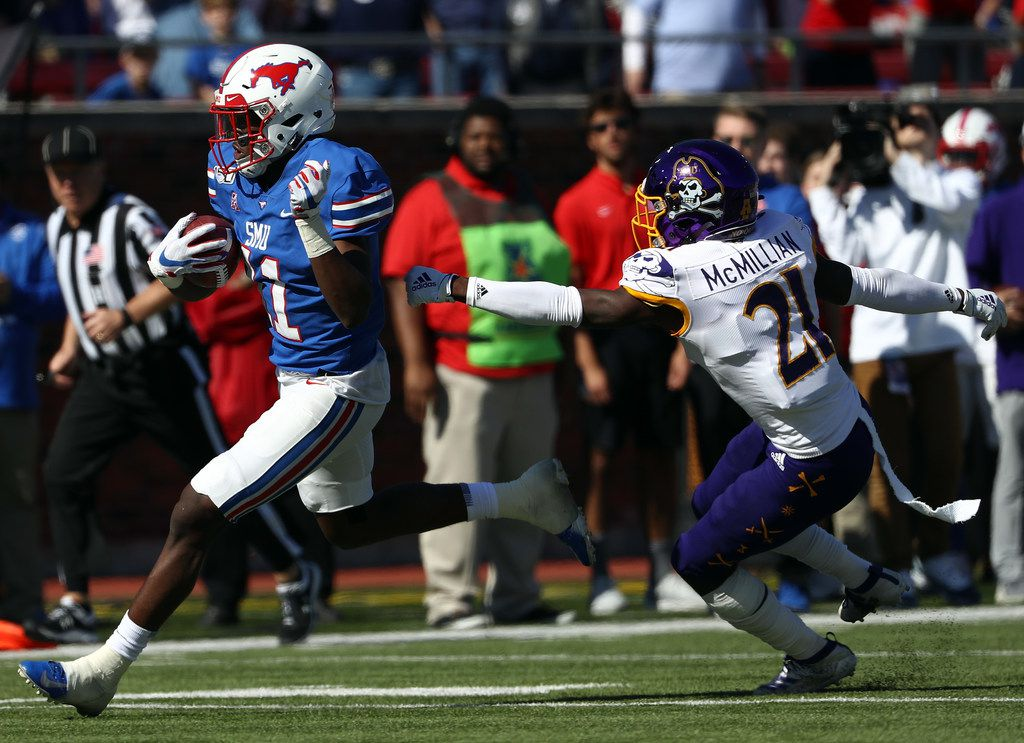 DALLAS, TEXAS - NOVEMBER 09:  Rashee Rice #11 of the Southern Methodist Mustangs runs the ball against Ja'Quan McMillian #21 of the East Carolina Pirates in the first half at Gerald J. Ford Stadium on November 09, 2019 in Dallas, Texas. (Photo by Ronald Martinez/Getty Images)