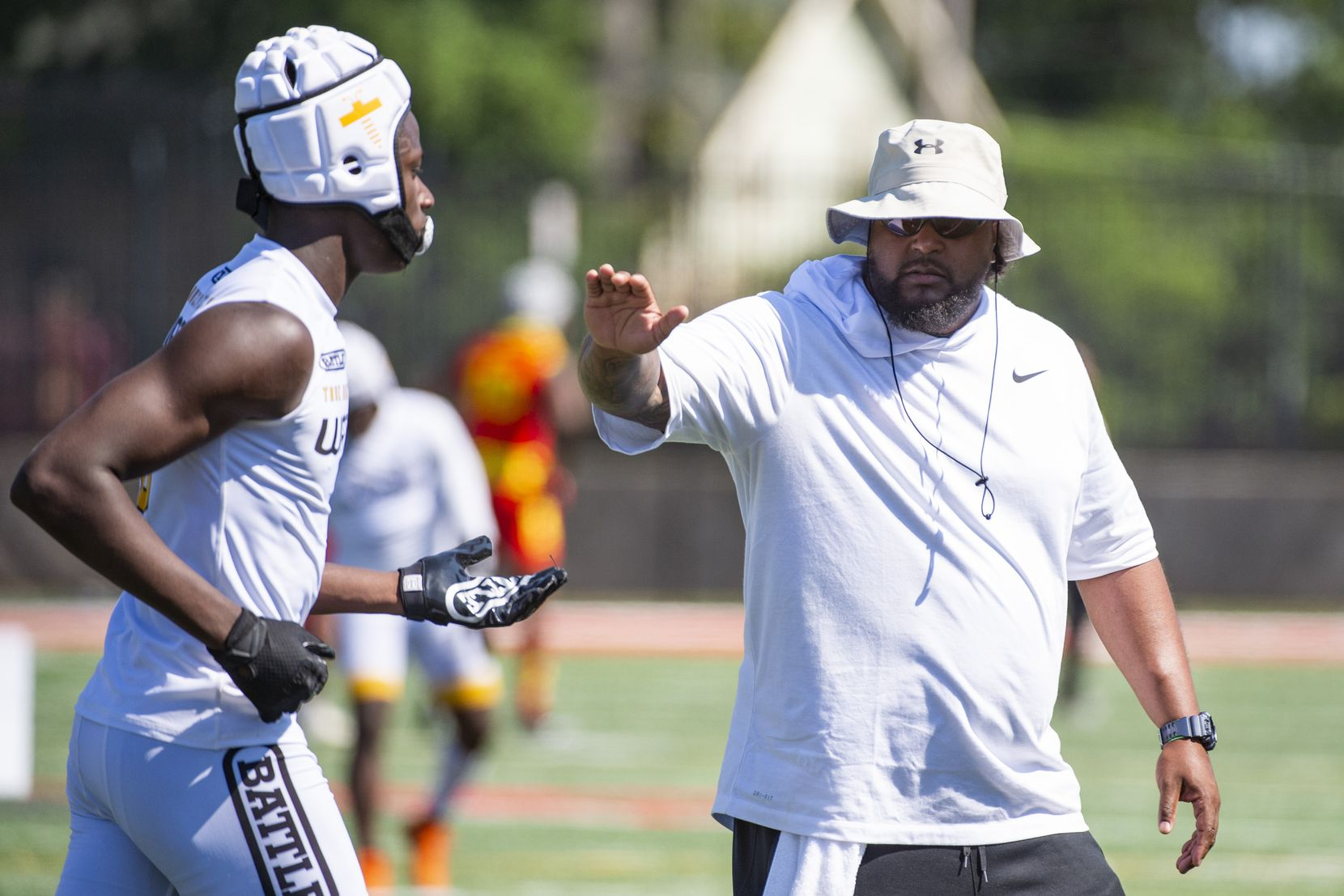 True Buzz coach Bell Cobbs congratulates Tristan Golightly after scoring a touchdown  during the Pylon 7v7 National Championship event held at Woodward Academy in Atlanta, Georgia, on May 26, 2019.