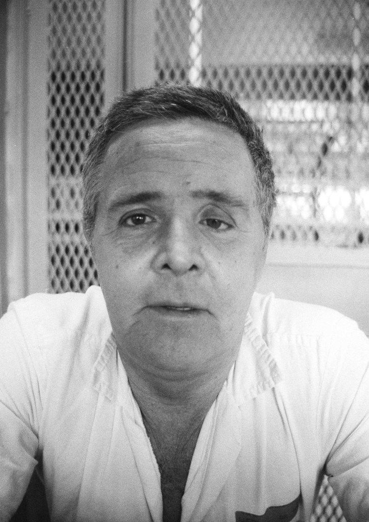 "This Oct. 10, 1990, file photo, shows convicted killer Henry Lee Lucas, on death row at Huntsville, Texas. Associated Press journalist Mike Graczyk, who witnessed and chronicled more than 400 executions as a criminal justice reporter in Texas, retired  July 31, 2018, after 45 years. Reflecting on Lucas, known as the ""one-eyed drifter,"" Graczyk said the inmate told him once that he took out his glass eye every night, placed it on a shelf in his cell and reminded new cell partners that if they considered stealing something from him, ""I've got my eye on you."""