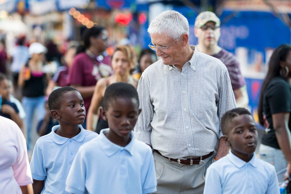 Don Williams, founder of non-profit corporation Foundation for Community Empowerment, walks down the Midway with students from Paul L Dunbar Elementary School during the State Fair of Texas at Fair Park on Oct. 19, 2016 in Dallas.