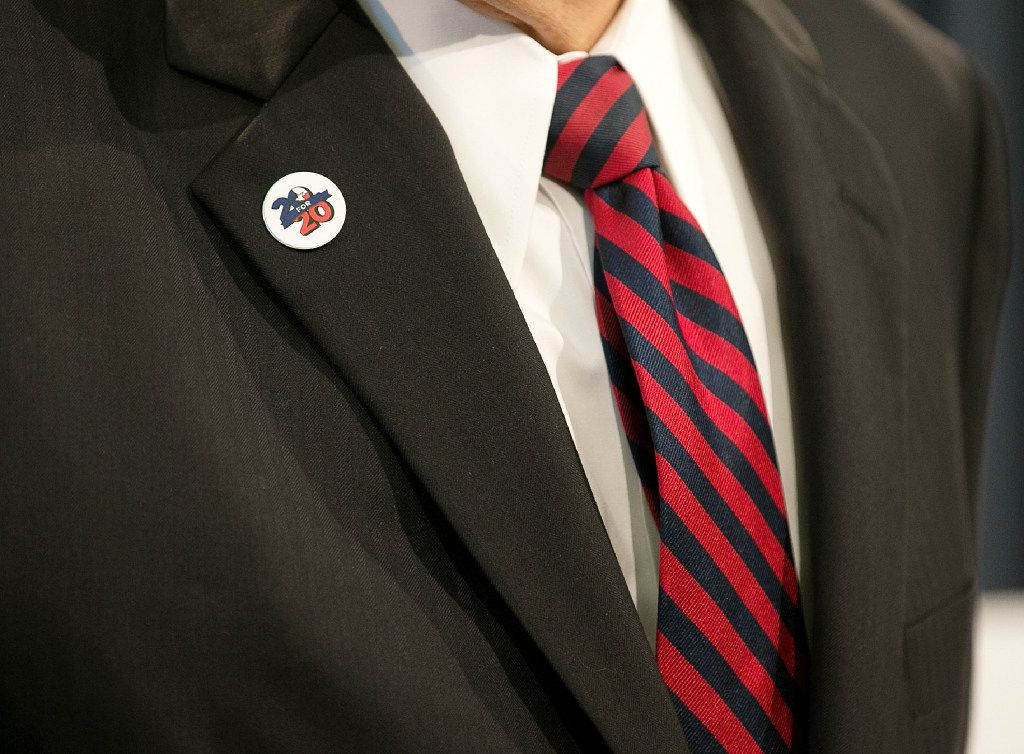 """Lt. Gov. Dan Patrick wears one of the """"20 for 20"""" pins Gov. Greg Abbott has been distributing, indicating a determination to pass all 20 items on Abbott's call for the special session."""