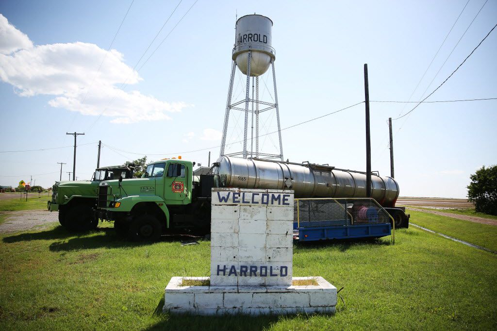 A welcome sign and the volunteer fire department are about the only thing left in the tiny Harrold community other than the school and nearly a dozen homes.