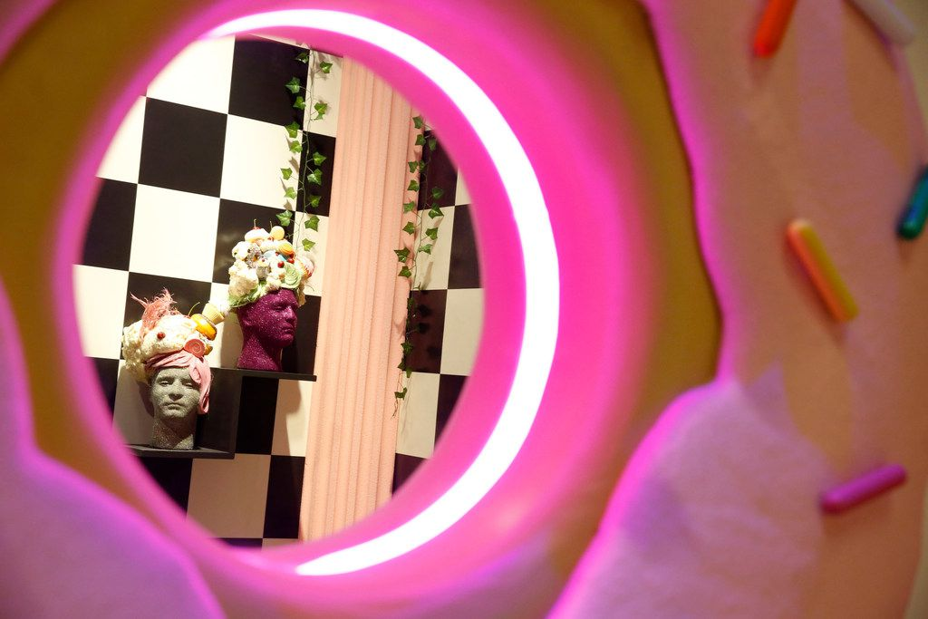 The bathroom in the Sweet Tooth Hotel was designed by Bender and Beau Bollinger. The giant doughnut mirror is one of the most delicious parts.
