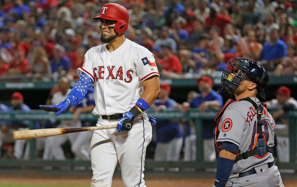 Texas Rangers Robinson Chirinos (61) watches the flight of a long foul fly that he hit with the bases loaded in the eighth inning during the Houston Astros vs. the Texas Rangers major league baseball game at Globe Life Park in Arlington, Texas, on Tuesday, July 3, 2018. (Louis DeLuca/The Dallas Morning News)