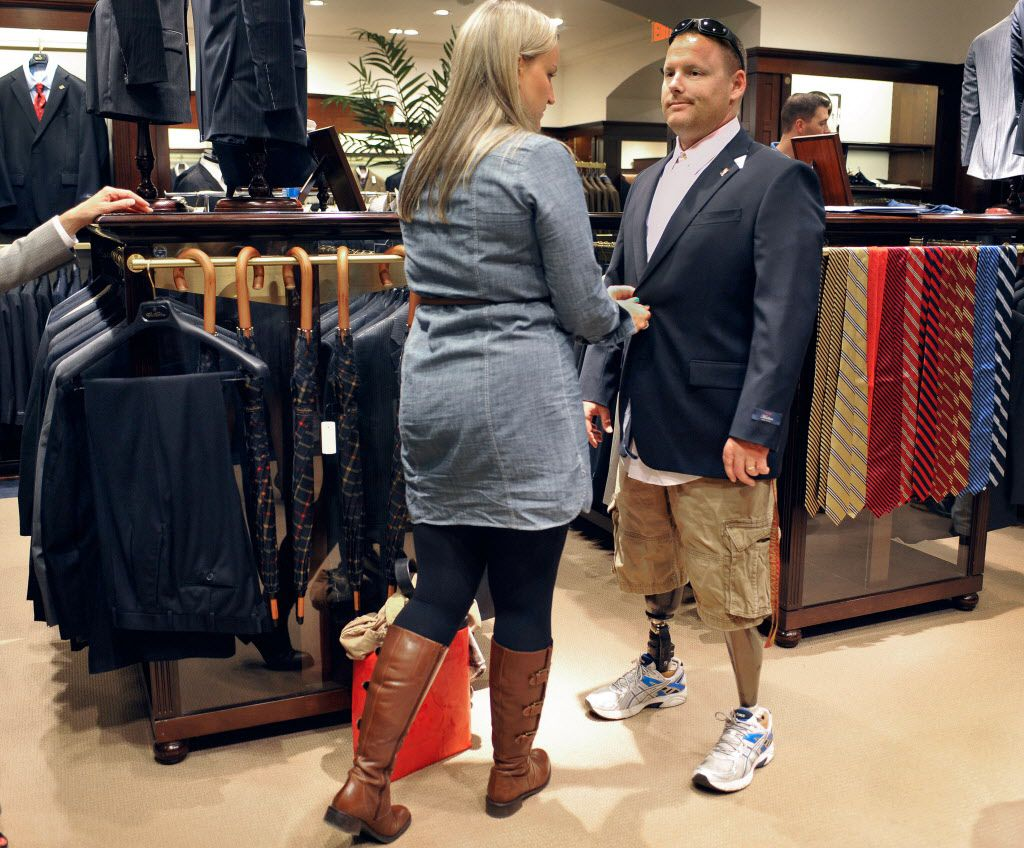 In this Sept. 20, 2012 photo, Marine Corps veteran Jared Luce of Coventry, Conn., is fitted with a new suit at a Brooks Brothers store in West Hartford, Conn. (AP Photo/Jessica Hill)