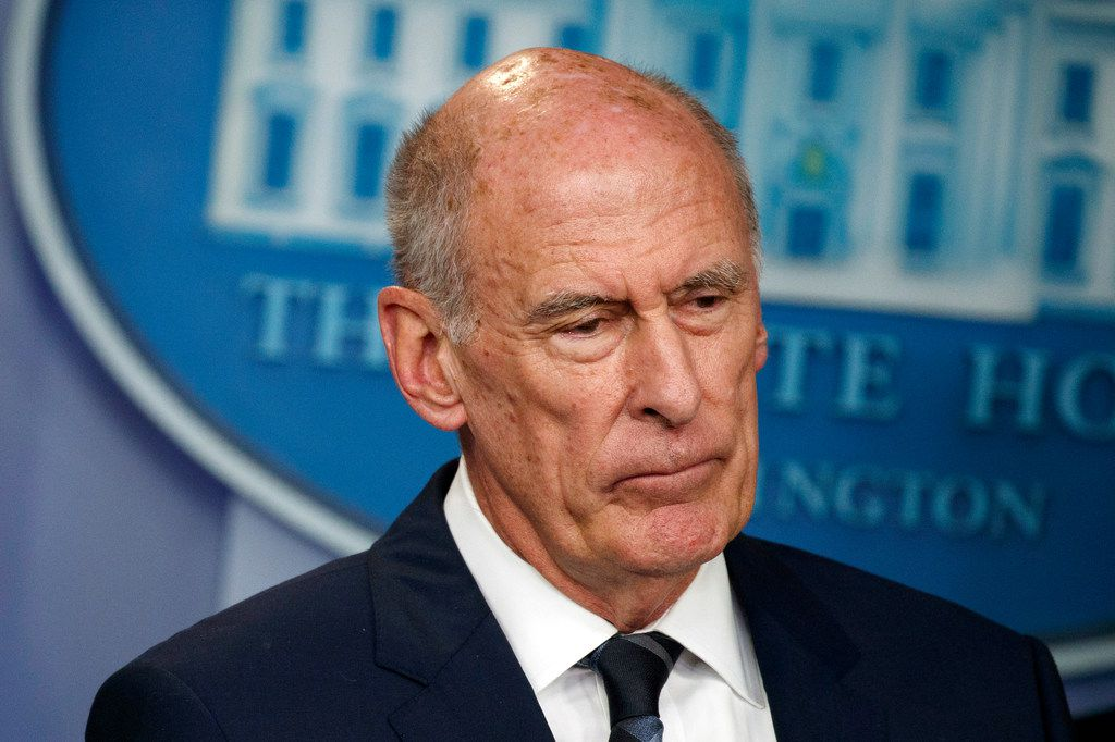 Director of National Intelligence Dan Coats listened during a daily press briefing at the White House in Washington on Aug. 2. Coats is to resign in days, after a two-year tenure marked by President Donald Trump's clashes with intelligence officials, U.S. officials said on Sunday, July 28, 2019.
