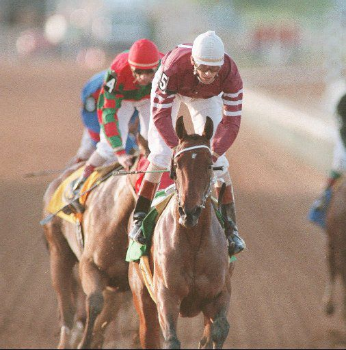 First Oasis with jockey Glenn Murphy up wins the first race at the new Retama Park racetrack in Selma, Texas, Friday, April 7 1995. The number four horse Peaches n' Delight ridden by Susan L. Cate finished second in the race. Big-time horse racing returned to the San Antonio area for the first time in 58 years with the first race at the park.