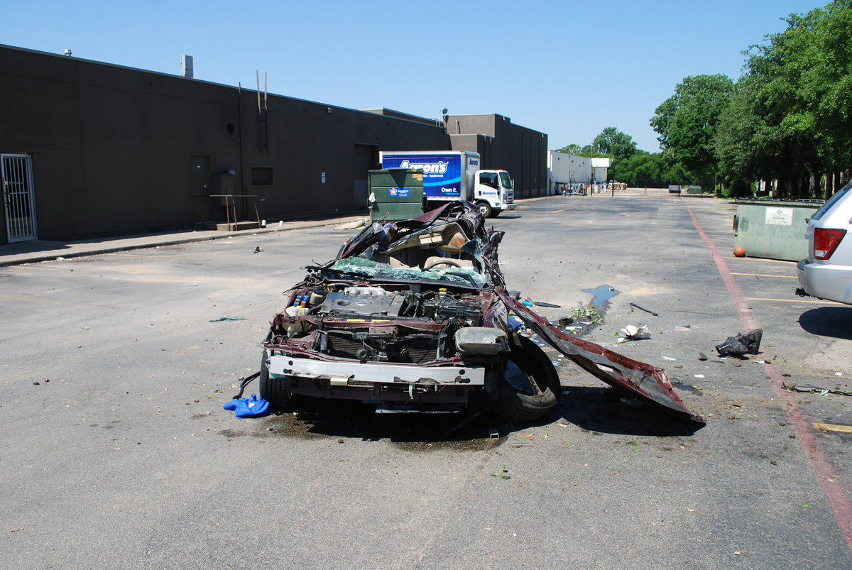 The stolen car was totaled after the driver lost control and the vehicle rolled a number of times.