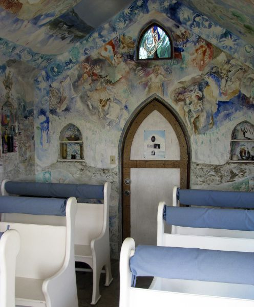 The chapel's interior murals were painted as a gift by Austin artist John Cobb in the 1970s,