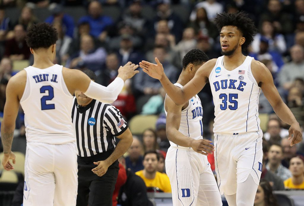 PITTSBURGH, PA - MARCH 15:  Marvin Bagley III #35 of the Duke Blue Devils celebrates with teammate Gary Trent Jr. #2 after hitting a three pointer against the Iona Gaels during the first half of the game in the first round of the 2018 NCAA Men's Basketball Tournament at PPG PAINTS Arena on March 15, 2018 in Pittsburgh, Pennsylvania.  (Photo by Rob Carr/Getty Images)