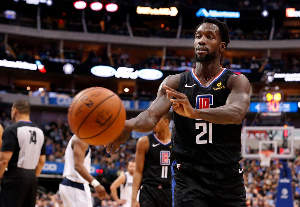 Los Angeles Clippers guard Patrick Beverley (21) throws a ball at a fan during the second half of an NBA basketball game against the Dallas Mavericks in Dallas, Sunday, Dec. 2, 2018. Dallas won 114-110. Beverley was ejected from the game. (AP Photo/Michael Ainsworth)