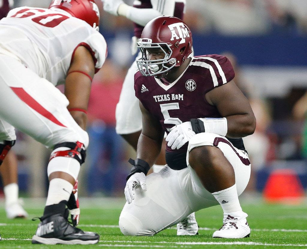 Texas A&M Aggies defensive lineman Daylon Mack (5) prepares to pass rush the Arkansas Razorbacks in the first half of the Southwest Classic at AT&T Stadium in Arlington, Texas, Saturday, September 24, 2016. Texas A&M won, 45-24. (Tom Fox/The Dallas Morning News)