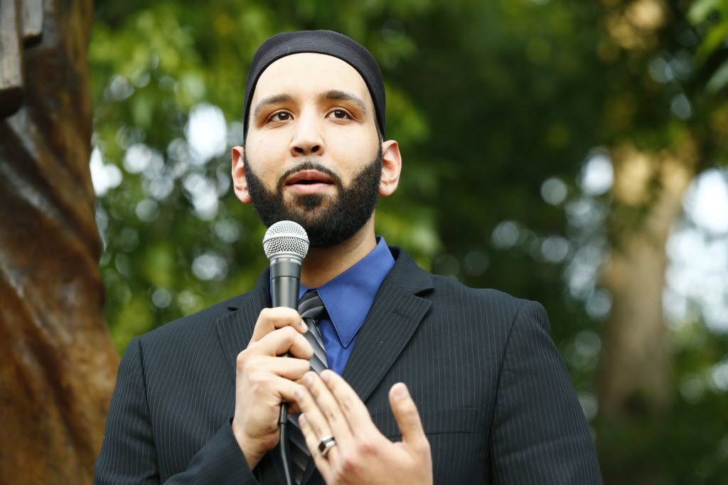 In this file photo, Imam Omar Suleiman speaks at a candlelight vigil for the victims and their families after shootings at a congregation in Charleston, S.C., in 2015. (Nathan Hunsinger/Staff)