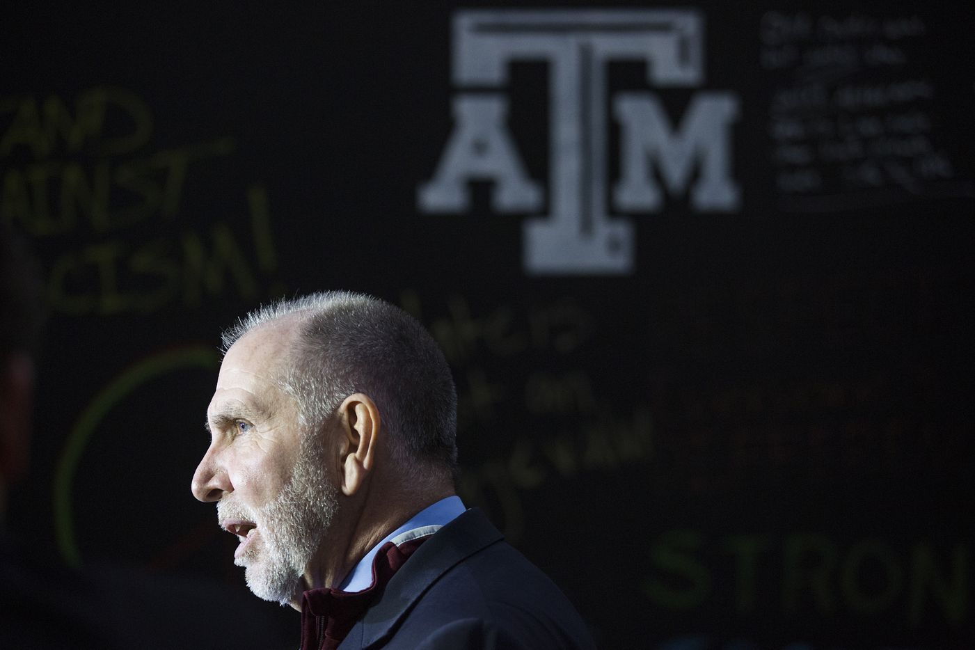 Michael K. Young, president of Texas A&M University, speaks to reporters before the Aggies United event at Kyle Field.