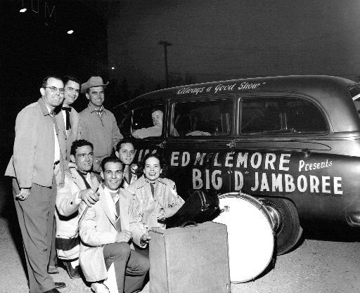 Charline Arthur (beside drum) and the Big D Jamboree crew ham it up outside the Dallas Sportatorium in this undated photo.