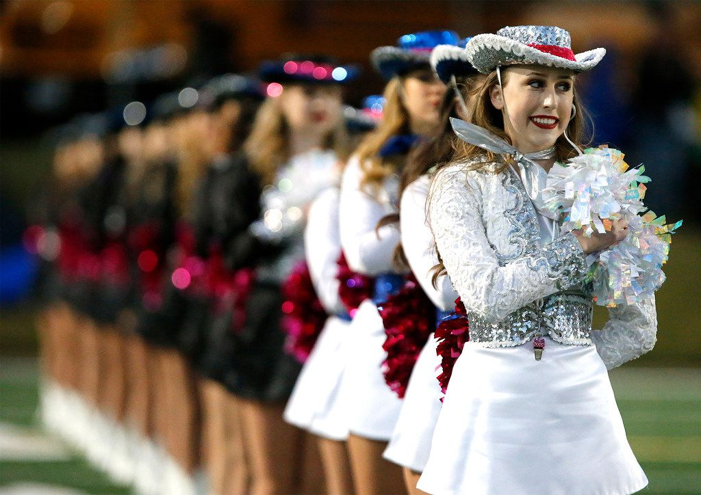 Samantha Hebert, a captain with the Plano West High School Royales drill team, stands at attention during the national anthem as Plano West High School hosted McKinney Boyd High School at Clark Stadium in Plano on Friday night, October 11, 2019. (Stewart F. House/Special Contributor)
