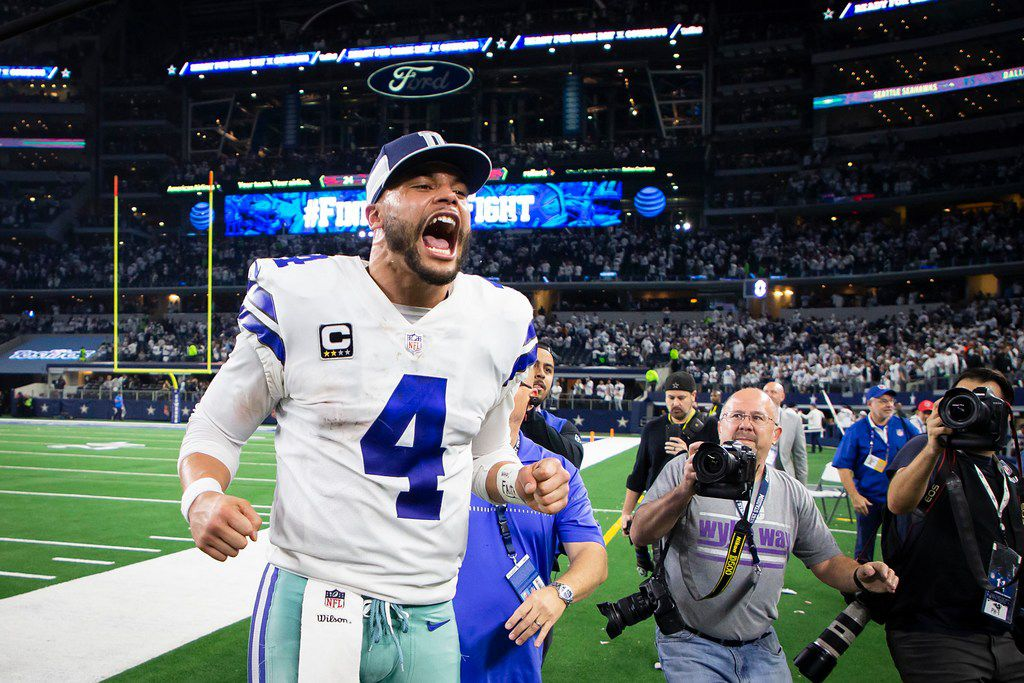 Dallas Cowboys quarterback Dak Prescott celebrates as he leaves the field following a victory over the Seattle Seahawks in an NFL wild-card playoff football game at AT&T Stadium on Saturday, Jan. 5, 2019, in Arlington. The Cowboys won the game 24-22. (Smiley N. Pool/The Dallas Morning News)