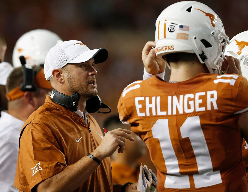 AUSTIN, TX - SEPTEMBER 15:  Head coach Tom Herman of the Texas Longhorns talks with Sam Ehlinger #11 of the Texas Longhorns during a timeout in the first half against the USC Trojans at Darrell K Royal-Texas Memorial Stadium on September 15, 2018 in Austin, Texas.  (Photo by Tim Warner/Getty Images) ORG XMIT: 775199044