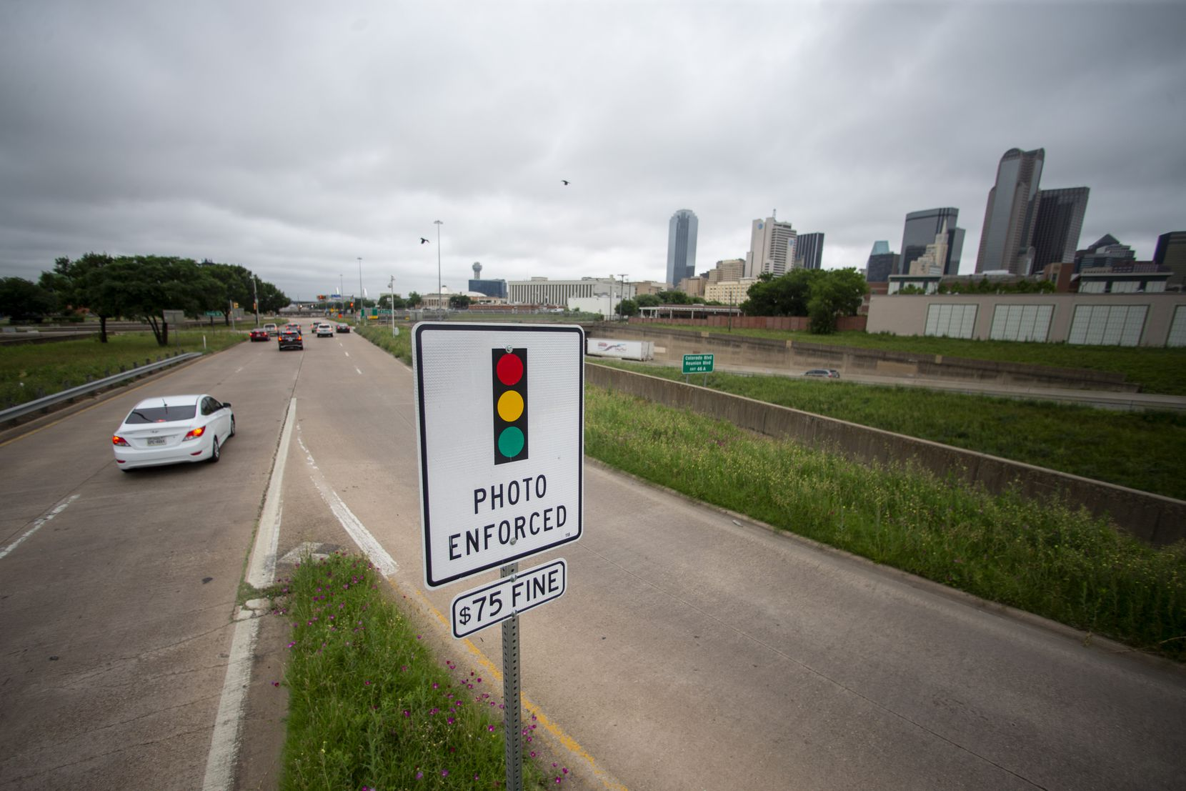 A red light camera warning sign is seen at the corner of South St. Paul Street and Griffin Street in Dallas on Wednesday, June 5, 2019.