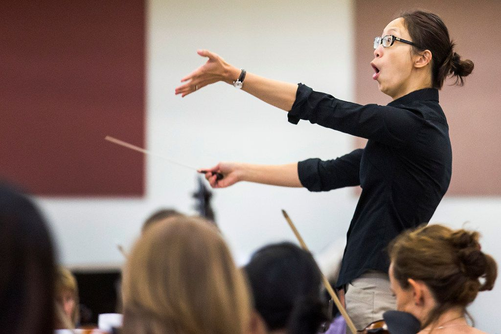 Chaowen Ting conducted the Dallas Opera Orchestra in rehearsal during the Linda and Mitch Hart Institute for Women Conductors program last week. (Smiley N. Pool/Staff Photographer)