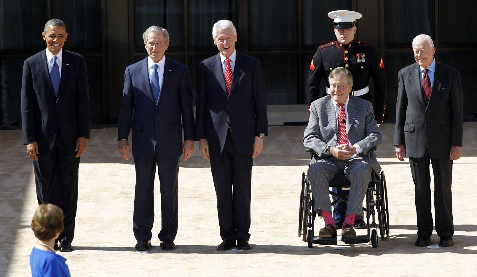 George H W  Bush dies at 94: president, family man, war hero