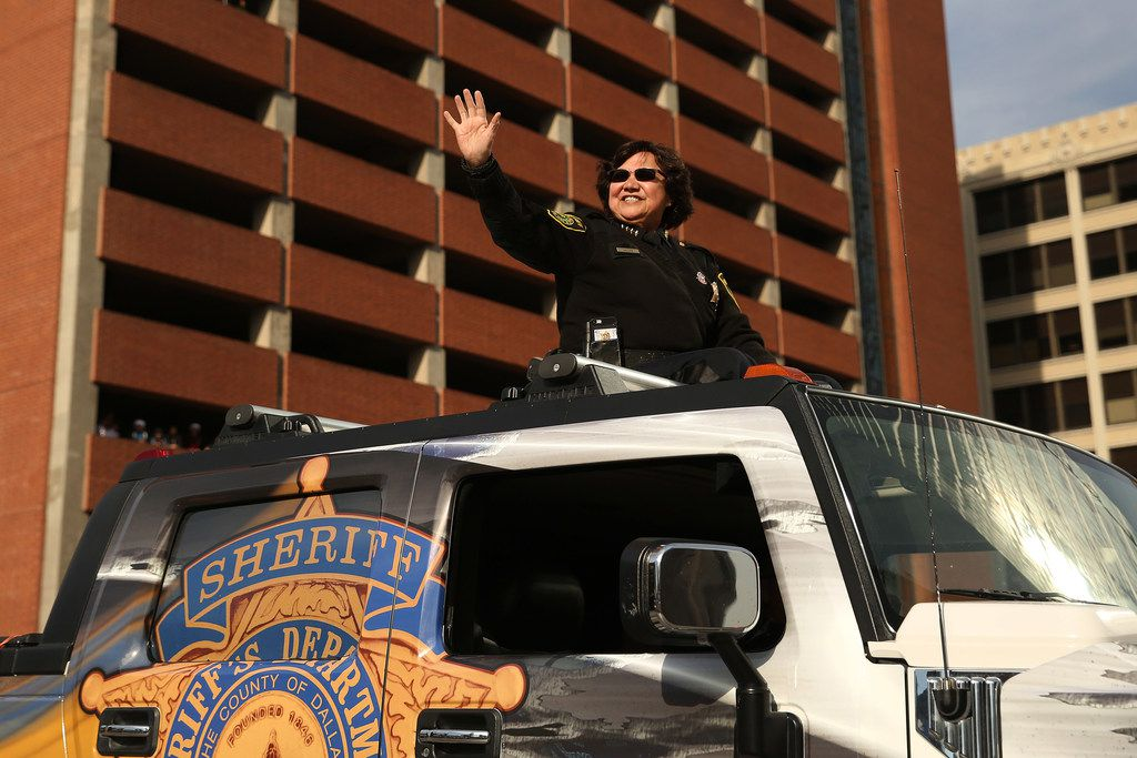 Dallas County Sheriff Lupe Valdez waved to the crowd during the Dallas Holiday Parade through downtown Dallas on Saturday.