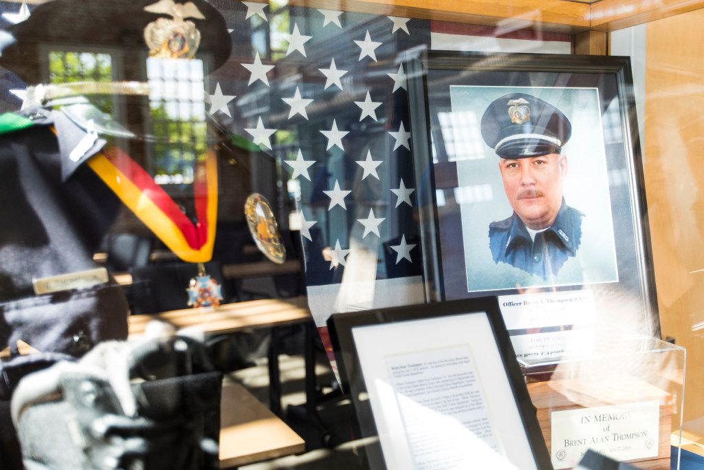 A display case at DART Police headquarters honors Officer Brent Thompson and includes the boots he wore on July 7. Thompson was the first DART officer killed in the line of duty.