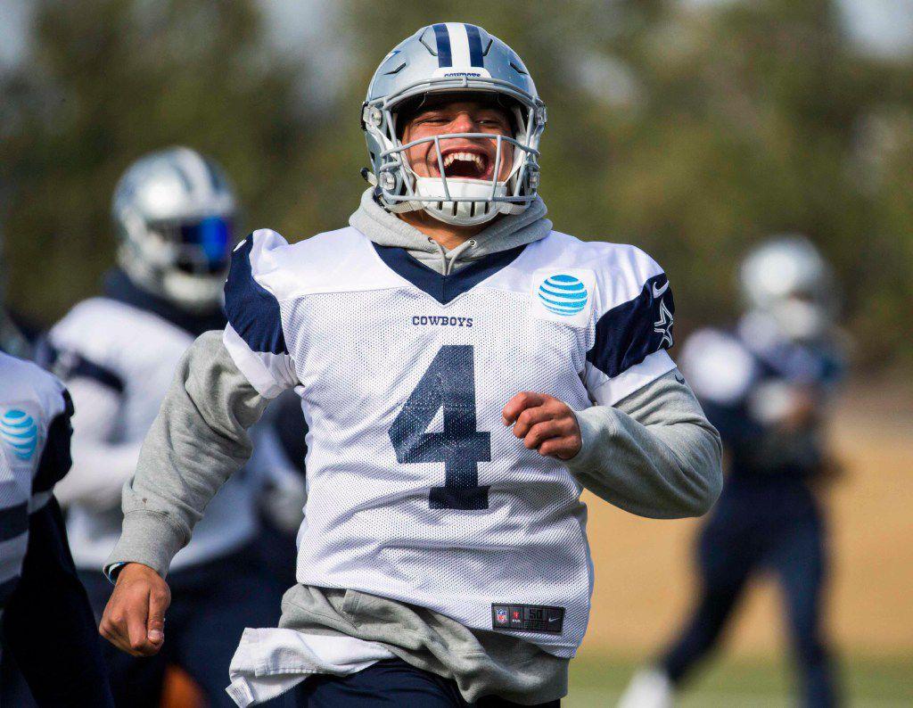 Dallas Cowboys quarterback Dak Prescott (4) smiles as he runs during their practice on Thursday, December 22, 2016 at The Star in Frisco, Texas. (Ashley Landis/The Dallas Morning News)