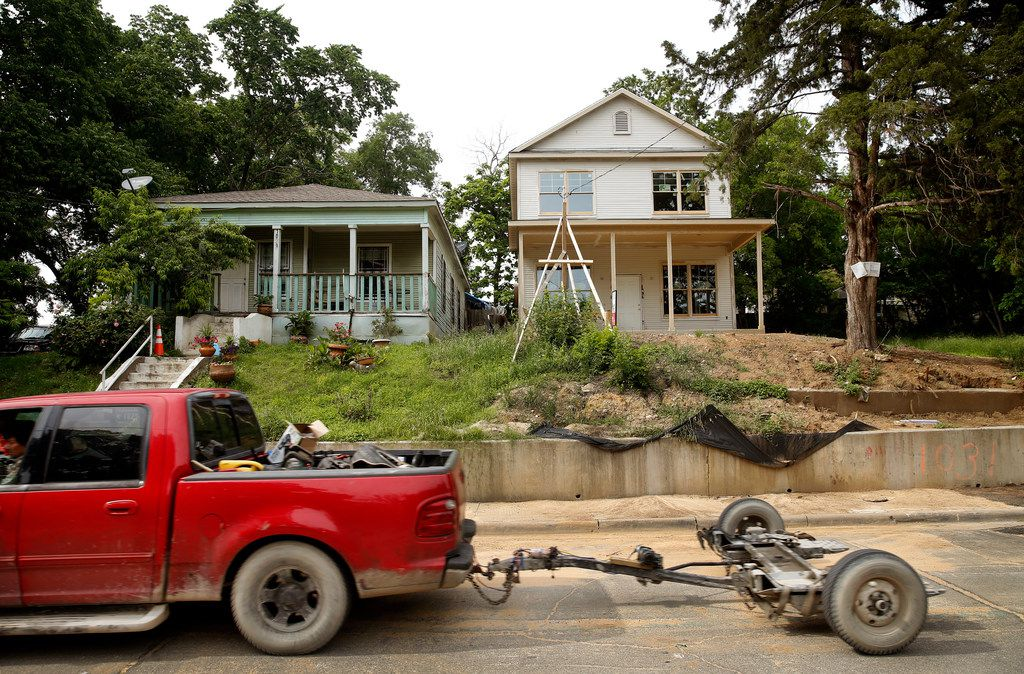 A new house is being built next to an old one on Church Street in the Tenth Street Historic District Freedmans Town of Dallas.