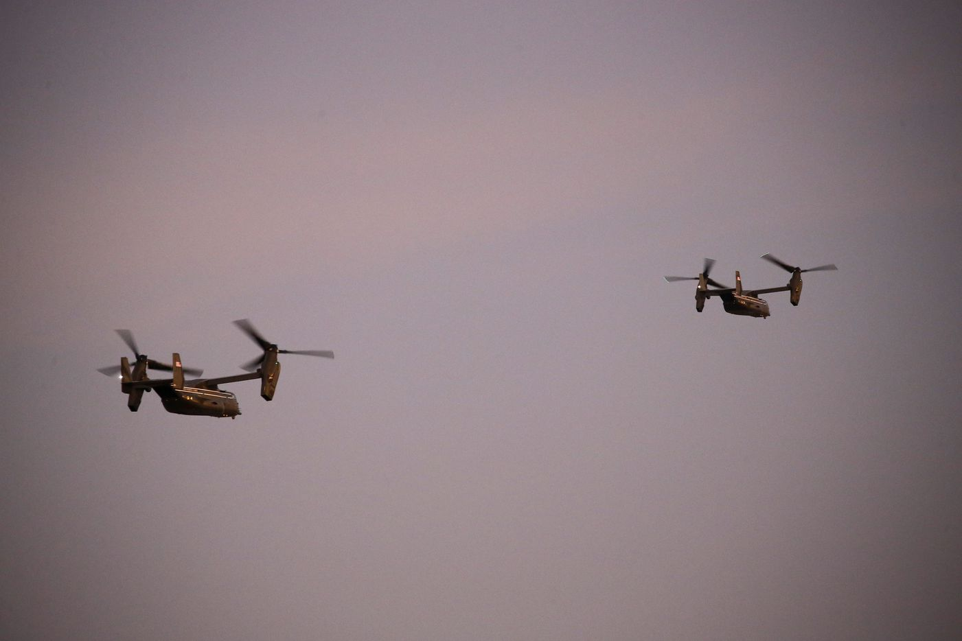 The Marine Helicopter Squadron One (HMX-1) including two escort V-22 Ospreys departs Love Field in Dallas after dropping off President Donald Trump for a rally, Thursday, October 17, 2019. He will hold a campaign rally at the American Airlines Center this evening.