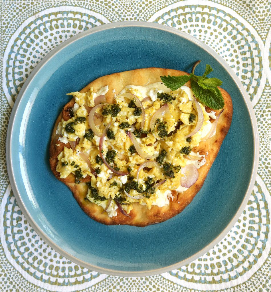 Breakfast flatbread with eggs, cheese, and parsley-mint pesto