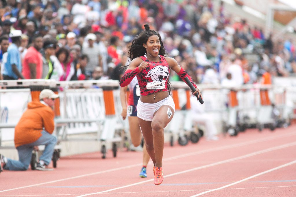 Mesquite Horn anchor Kaylor Harris, center, celebrates as she crosses the finish line during girls 4x100 meter relay at the 2017 Texas Relays at Mike A. Myers Stadium at the University of Texas at Austin, Texas on April 1, 2017. Mesquite Horn placed first with a time of 45.27. (Julia Robinson/Special Contributor)