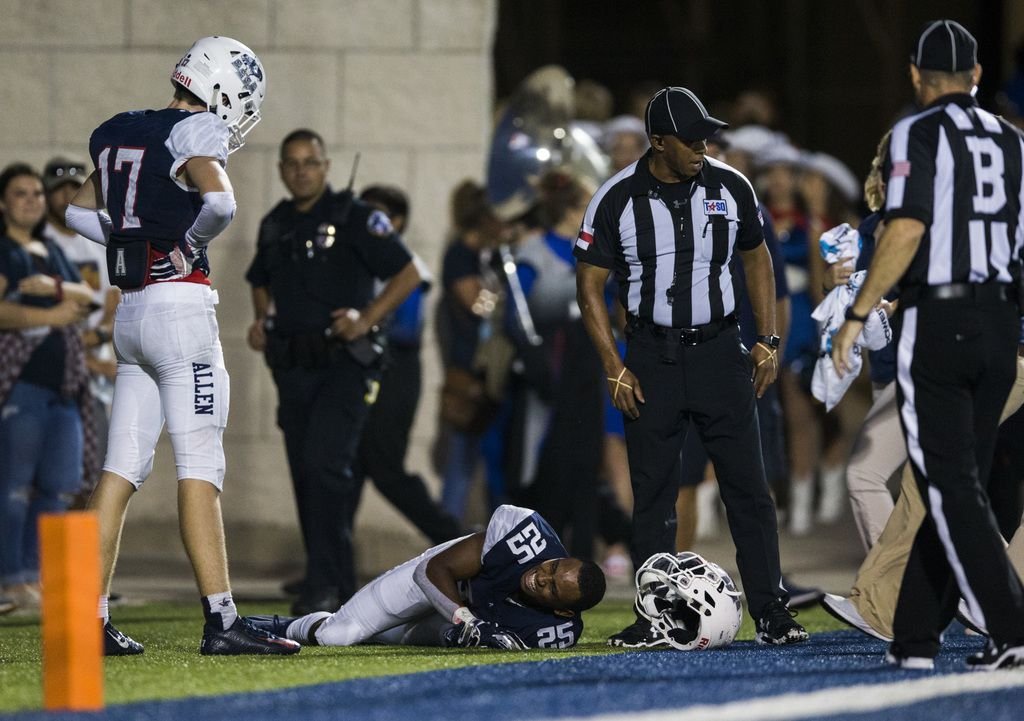 Allen defensive back Savion Richardson (25) is injured during the second quarter of a high school football game between Allen and Cedar Hill on Friday, August 30, 2019 at Eagle Stadium in Allen. (Ashley Landis/The Dallas Morning News)